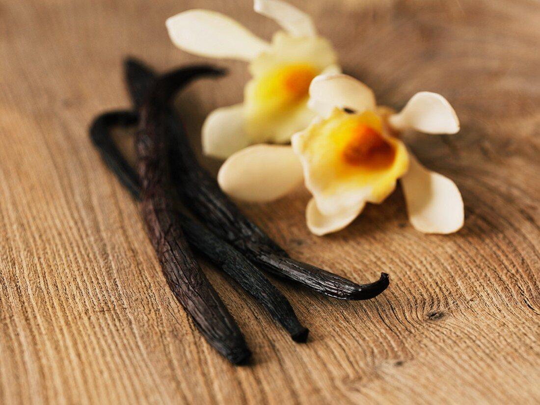An arrangement of vanilla pods and flowers