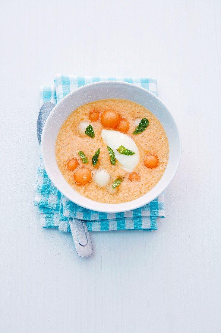 Cold melon soup with semolina dumplings