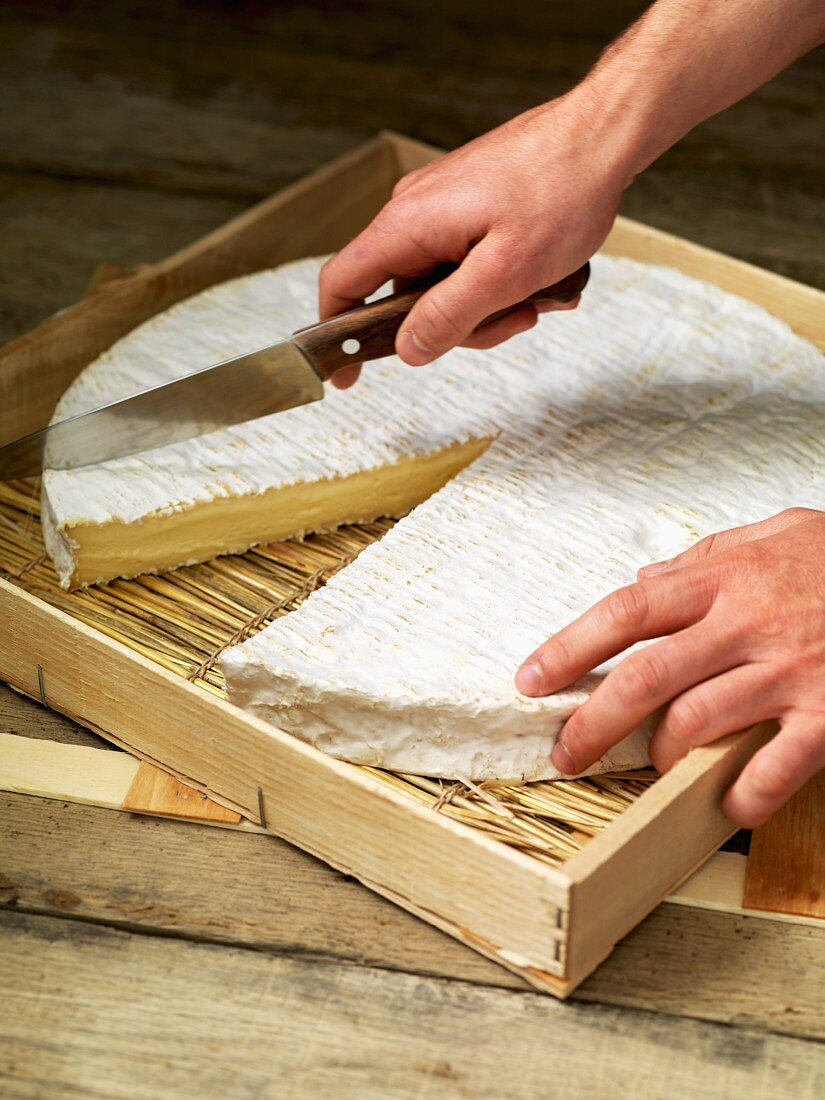 Brie being sliced