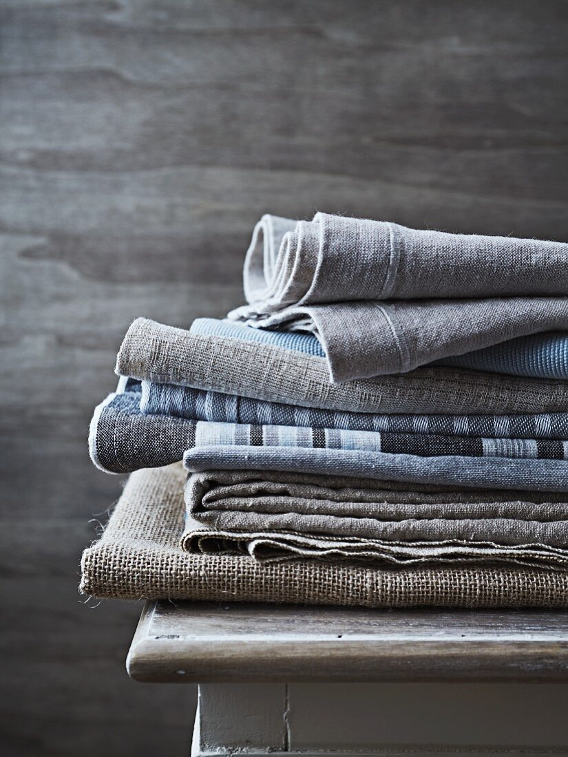 Folded and stacked cloths in natural fabrics (linen, cotton)