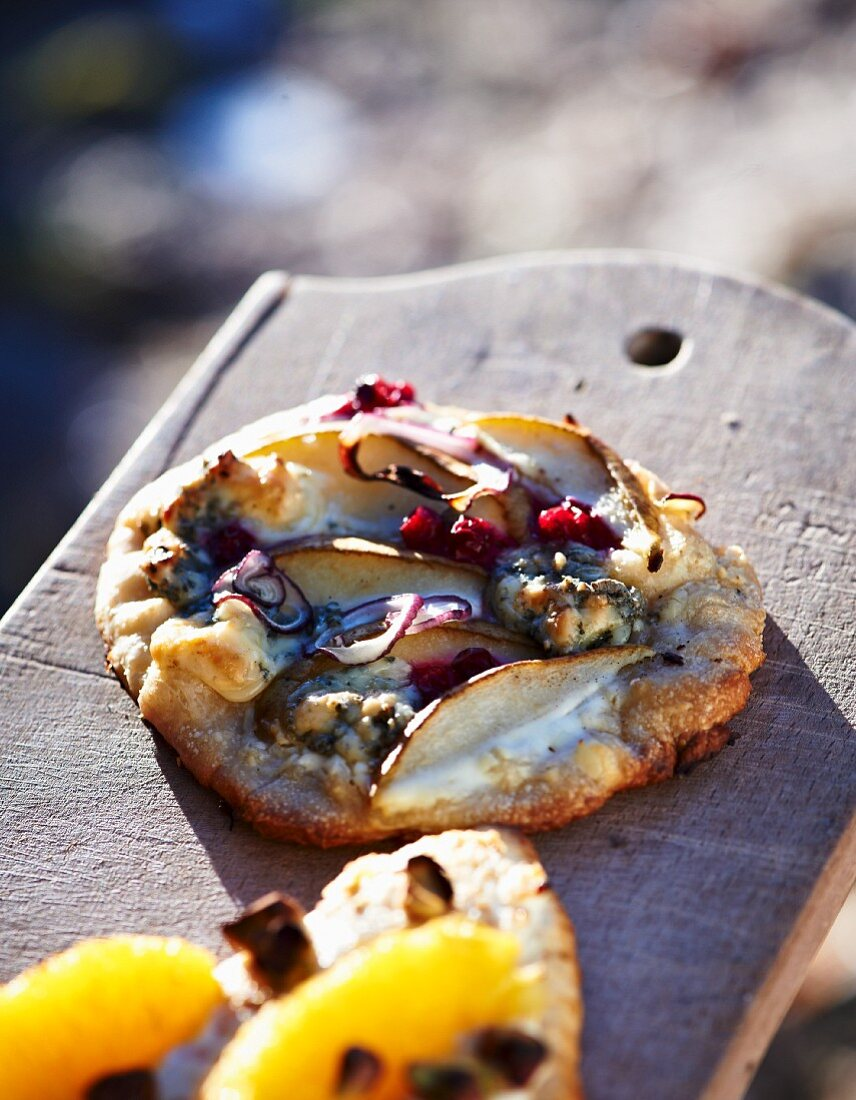 A winter pizza with pears, blue cheese and red onions