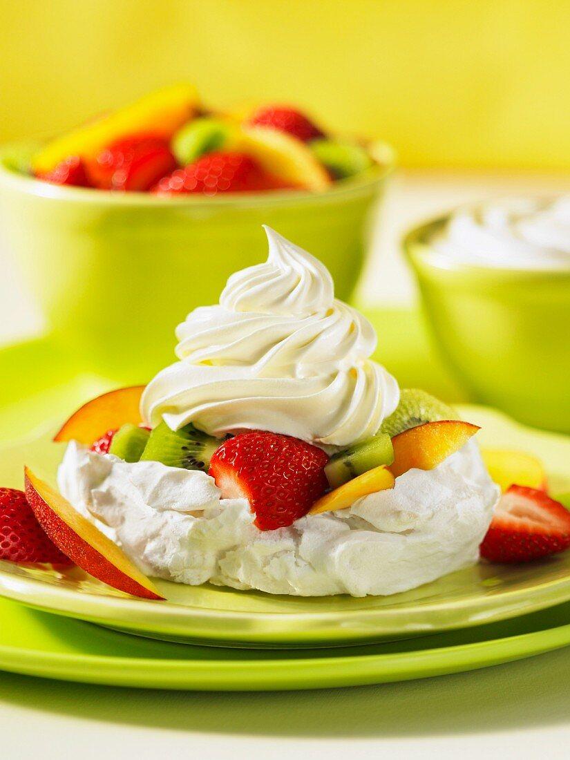Pavlova with kiwis and strawberries