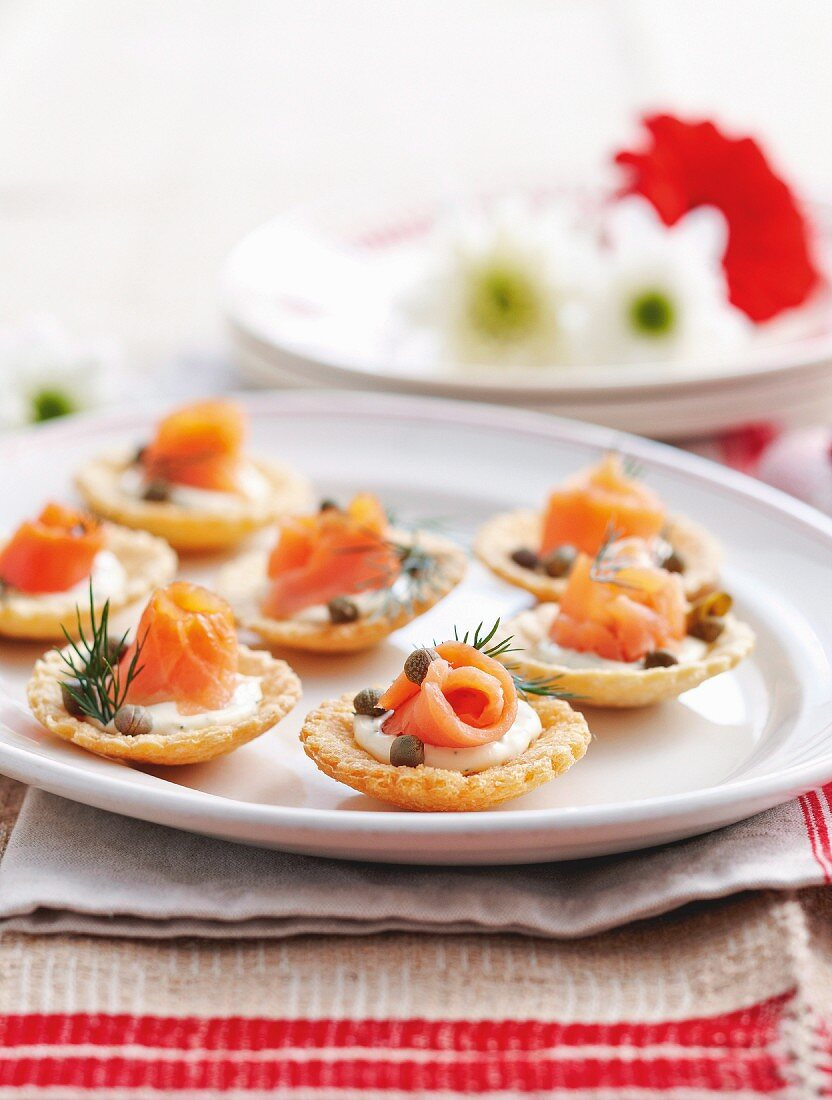 Tartlets topped with smoked salmon, creme fraiche and capers