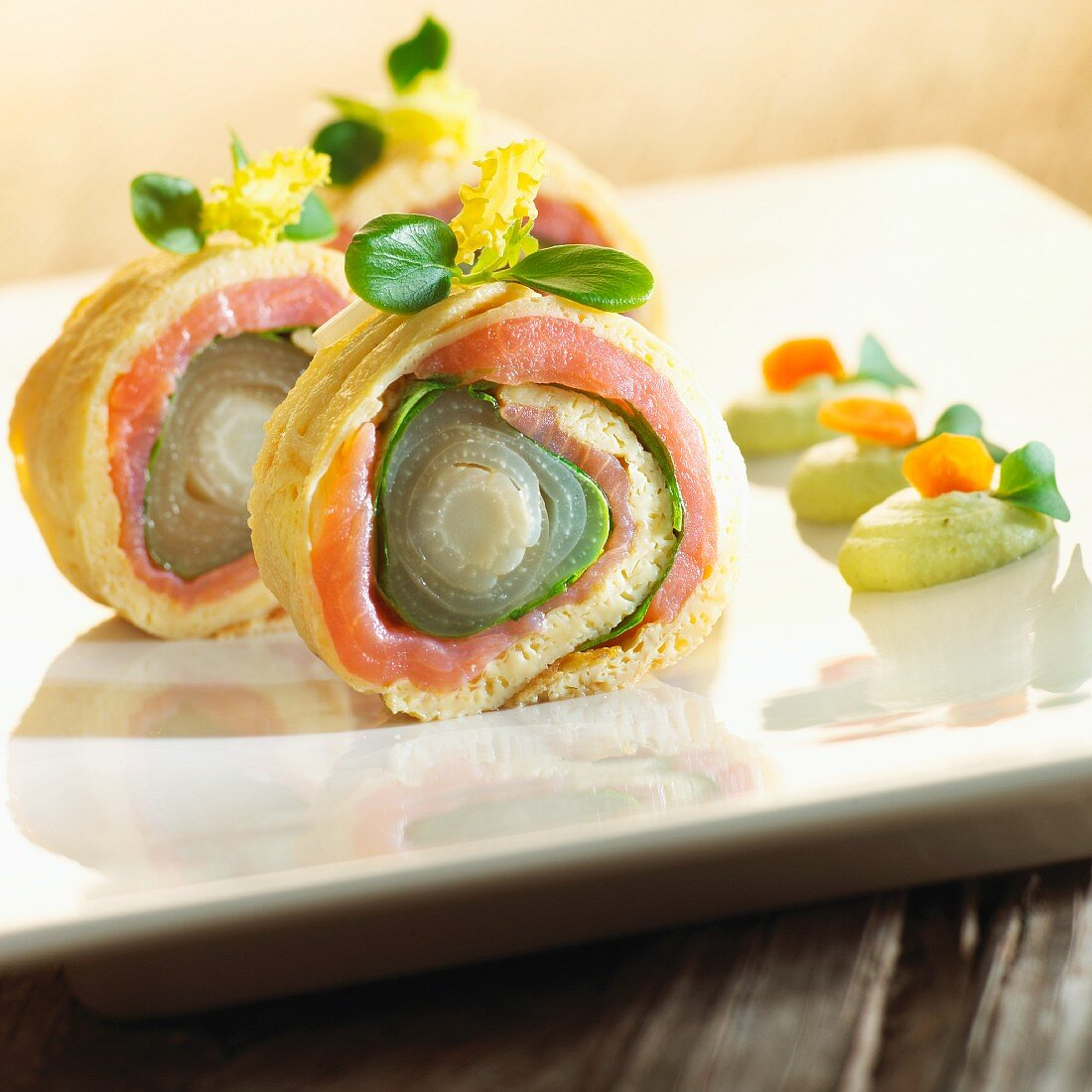 Omelette rolls filled with smoked salmon and chicory