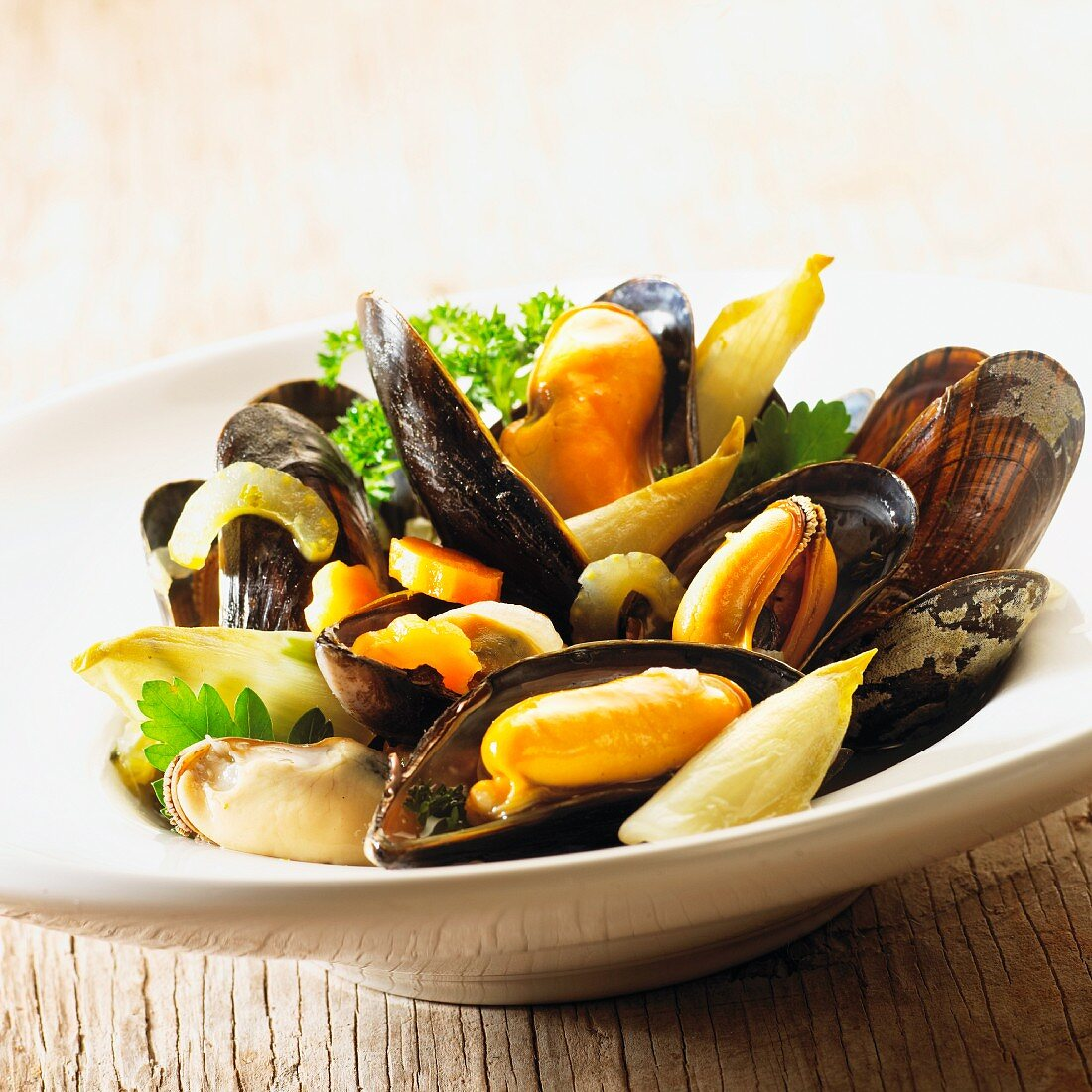 Mussels with chicory in a wheat beer broth
