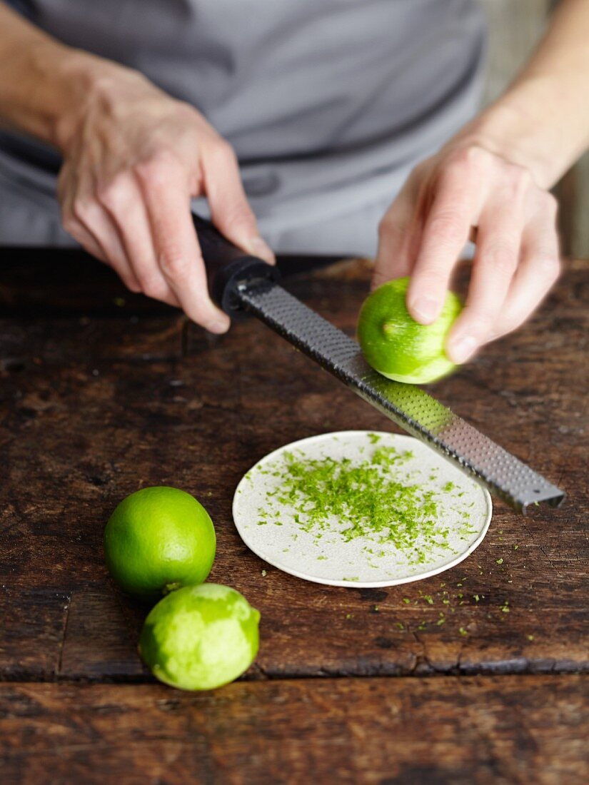 Lime zest being grated