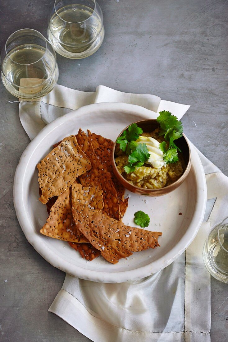 Aubergine dip with crispy quinoa bread chips