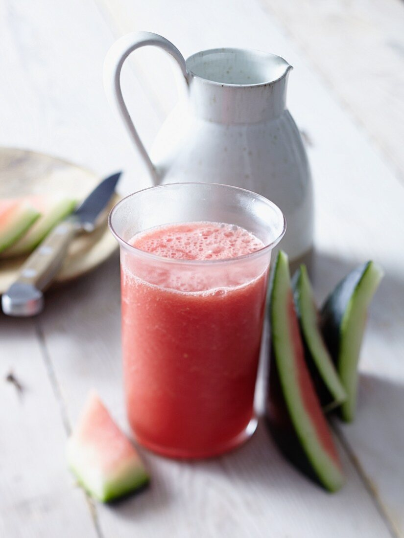 Watermelon Agua Fresca in Glasses and Pitcher; Fresh Watermelons and Limes