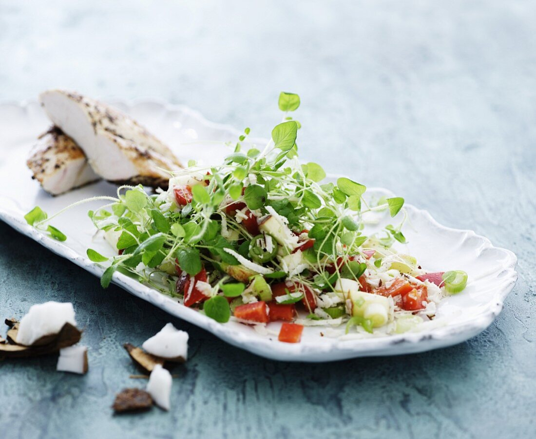 A shoots salad with coconut and chicken breast