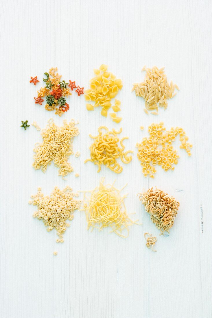 Piles of various soup noodles in different shapes and colours