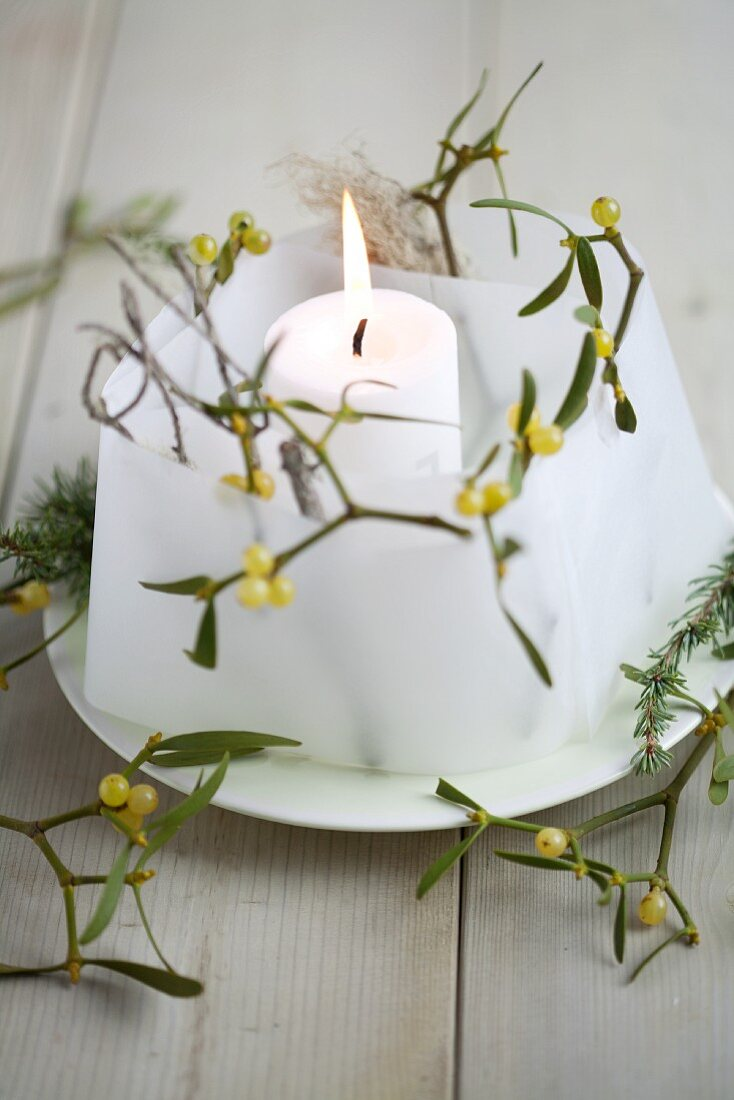Lantern made from parchment paper and sprigs of mistletoe