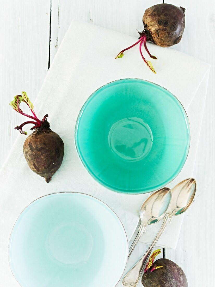Soup bowls, spoons and beetroot