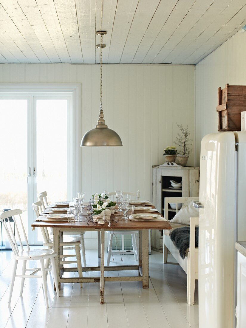 Set table in white kitchen