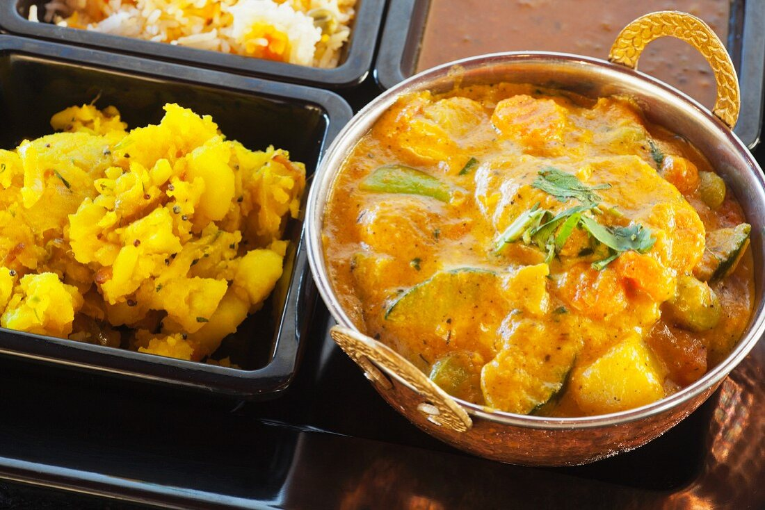 Navratan Korma with curried potatoes, rice, and lentils (India)
