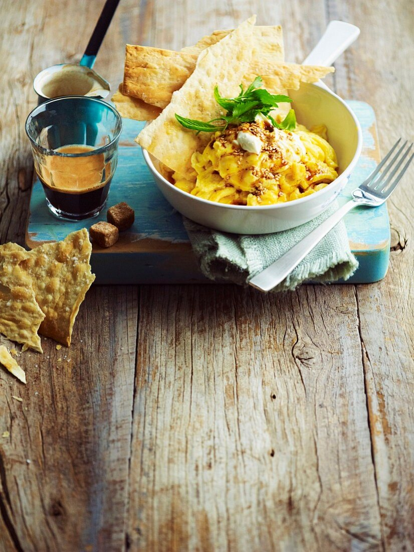 Scrambled egg with labneh and sesame seeds