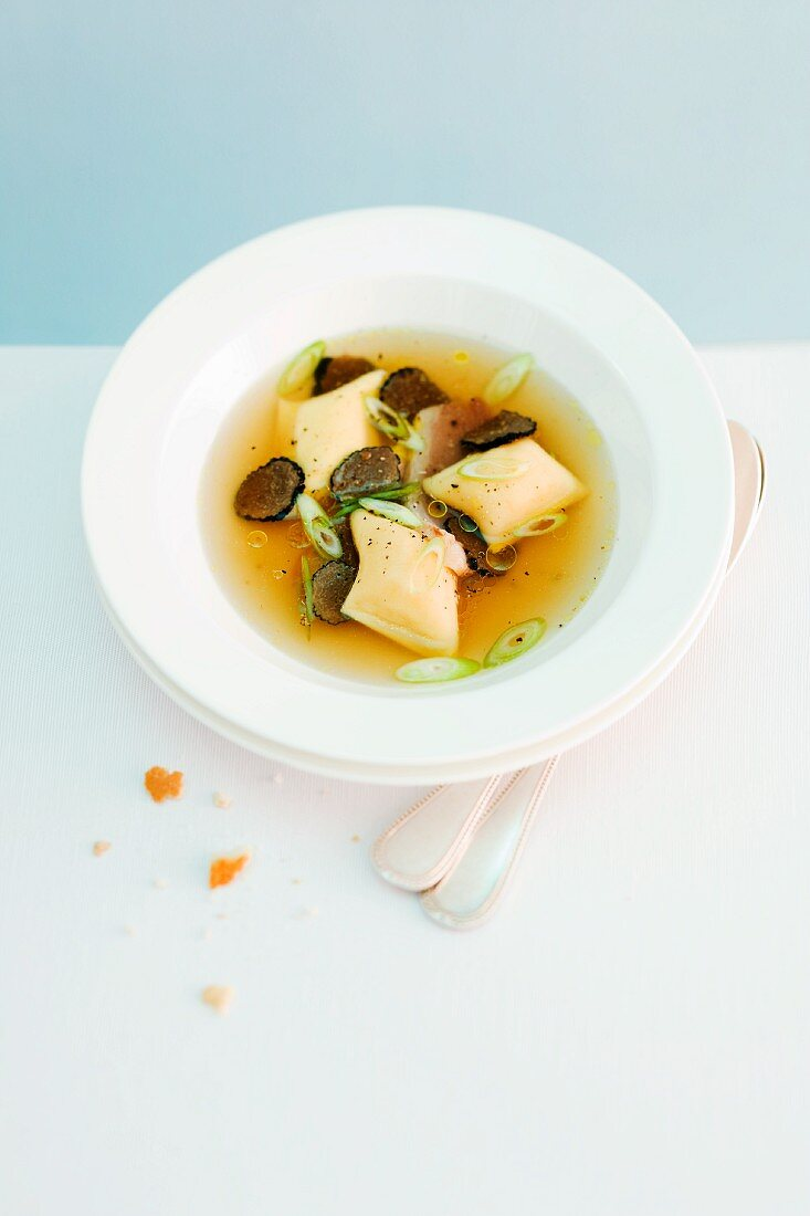 Spicy broth with duck breast and truffled onion ravioli
