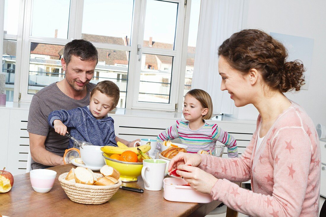 A family of four having a healthy breakfast