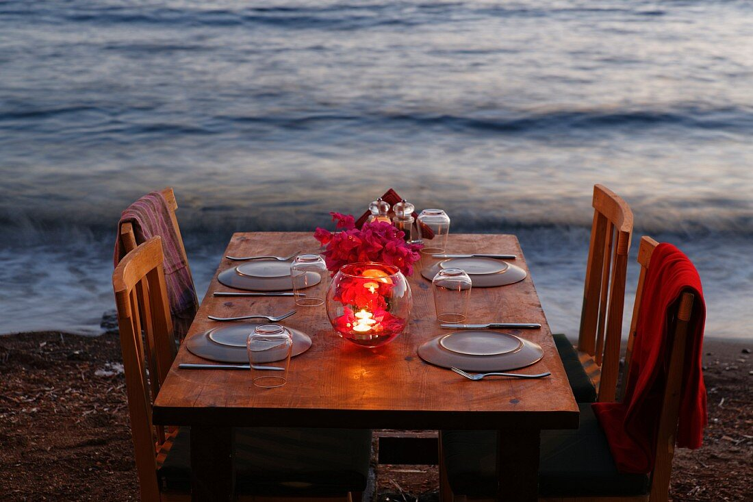 A table laid on a beach (Turkey)