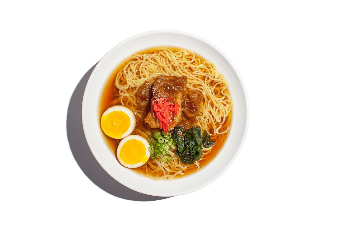 Shoyu ramen noodle soup with pork, ginger, spring onions, seaweed and egg (Japan)