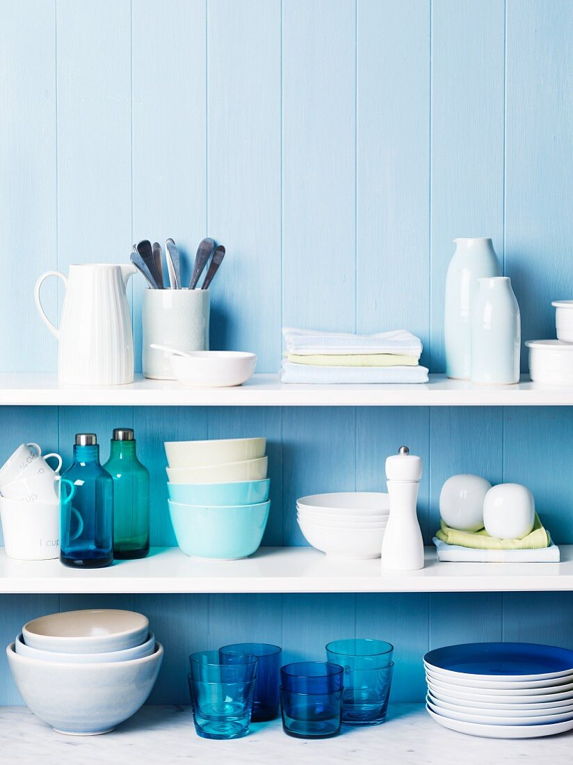 Kitchen shelves of crockery & utensils in shades of blue & white