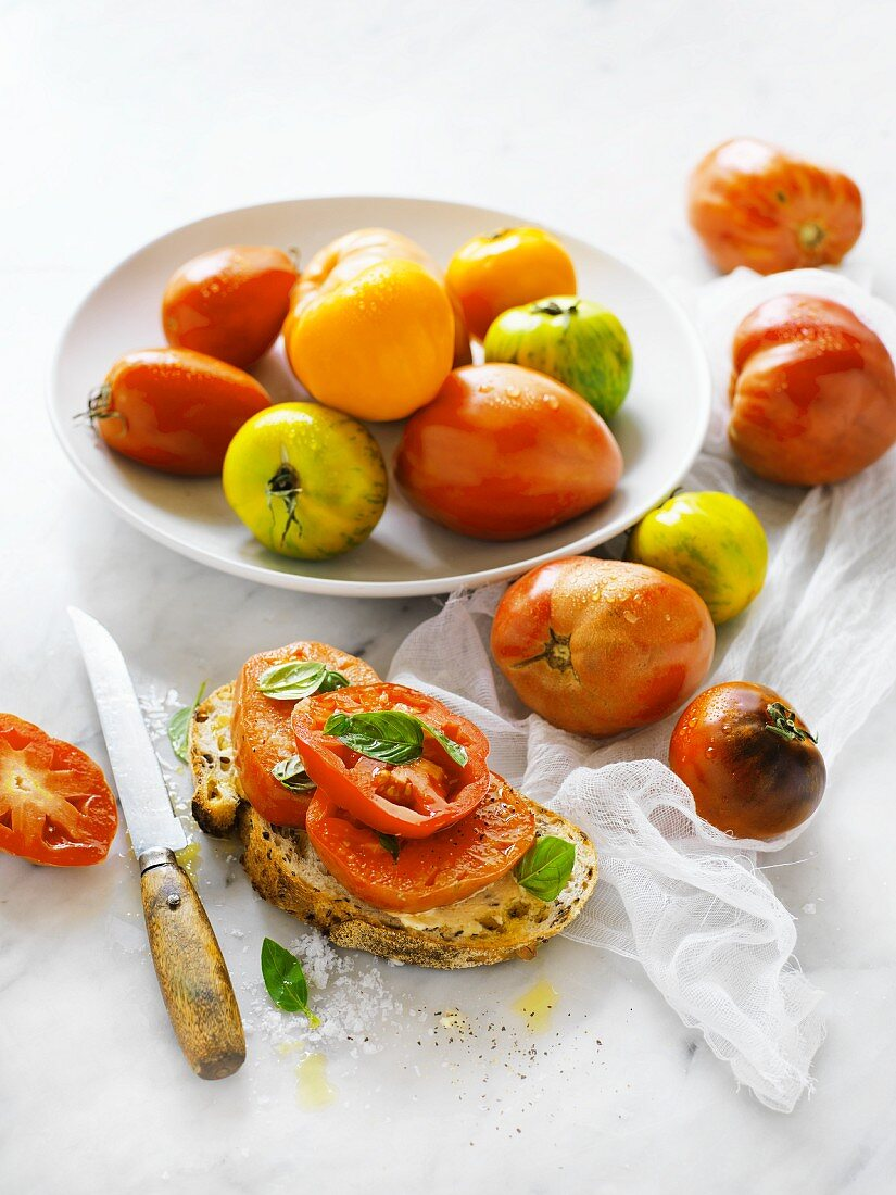 Beefsteak tomatoes, whole and sliced on bread
