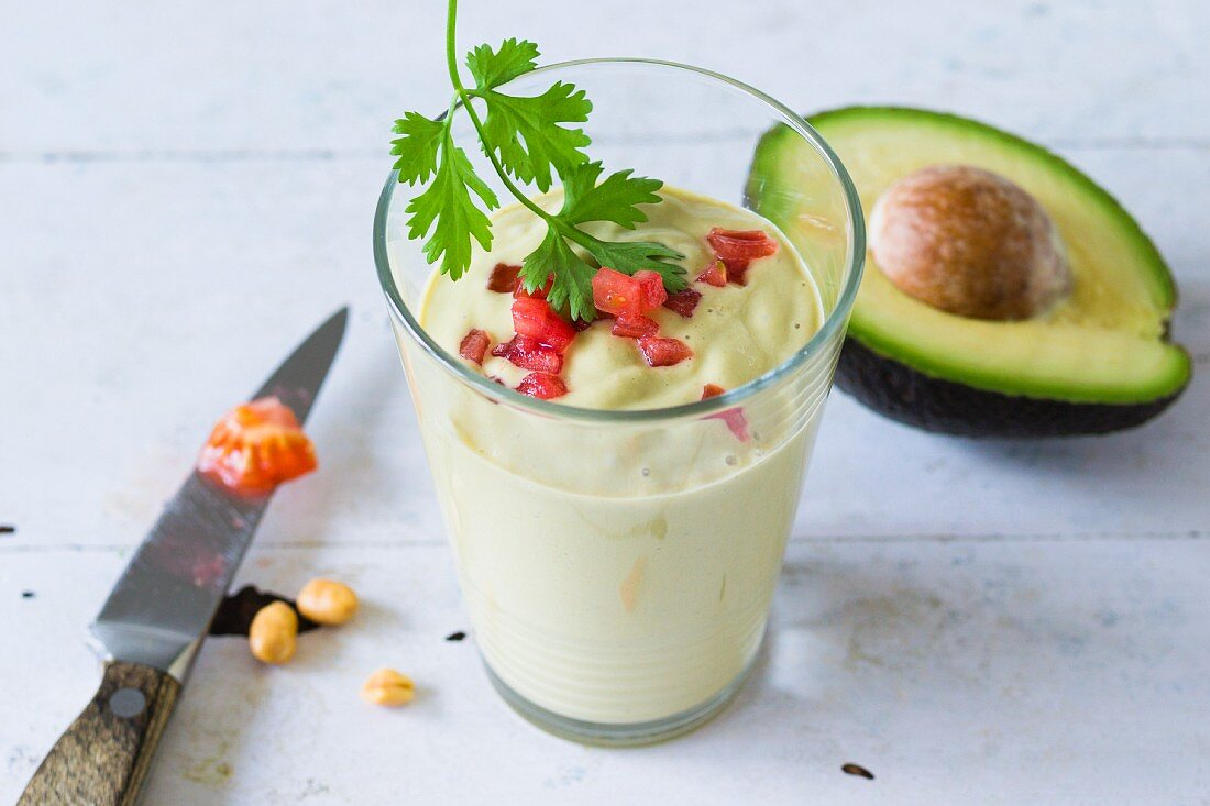 An avocado smoothie with kefir and diced tomatoes
