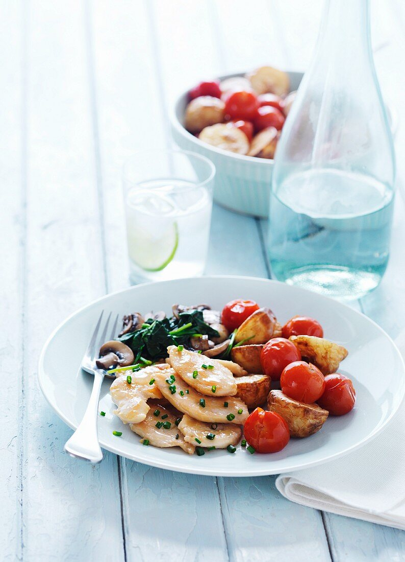 Verjus chicken with oven-roasted tomatoes and potatoes
