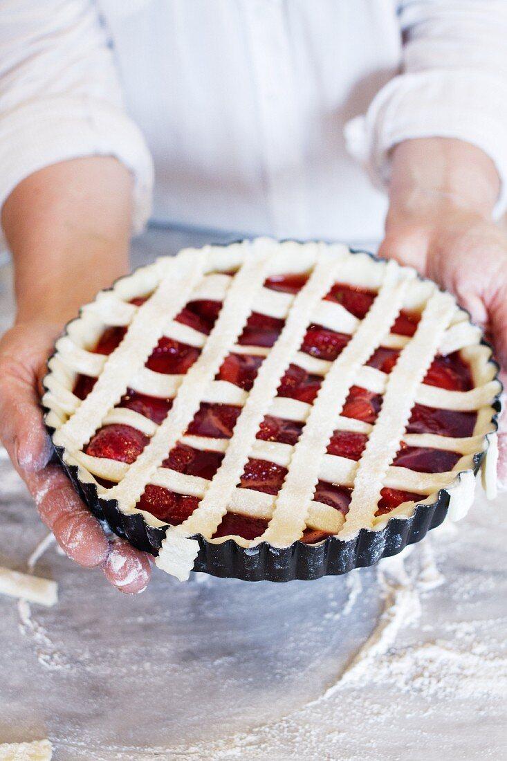 An unbaked plum tart