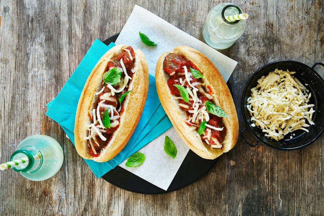 Baguette sandwiches with meatballs and cheese