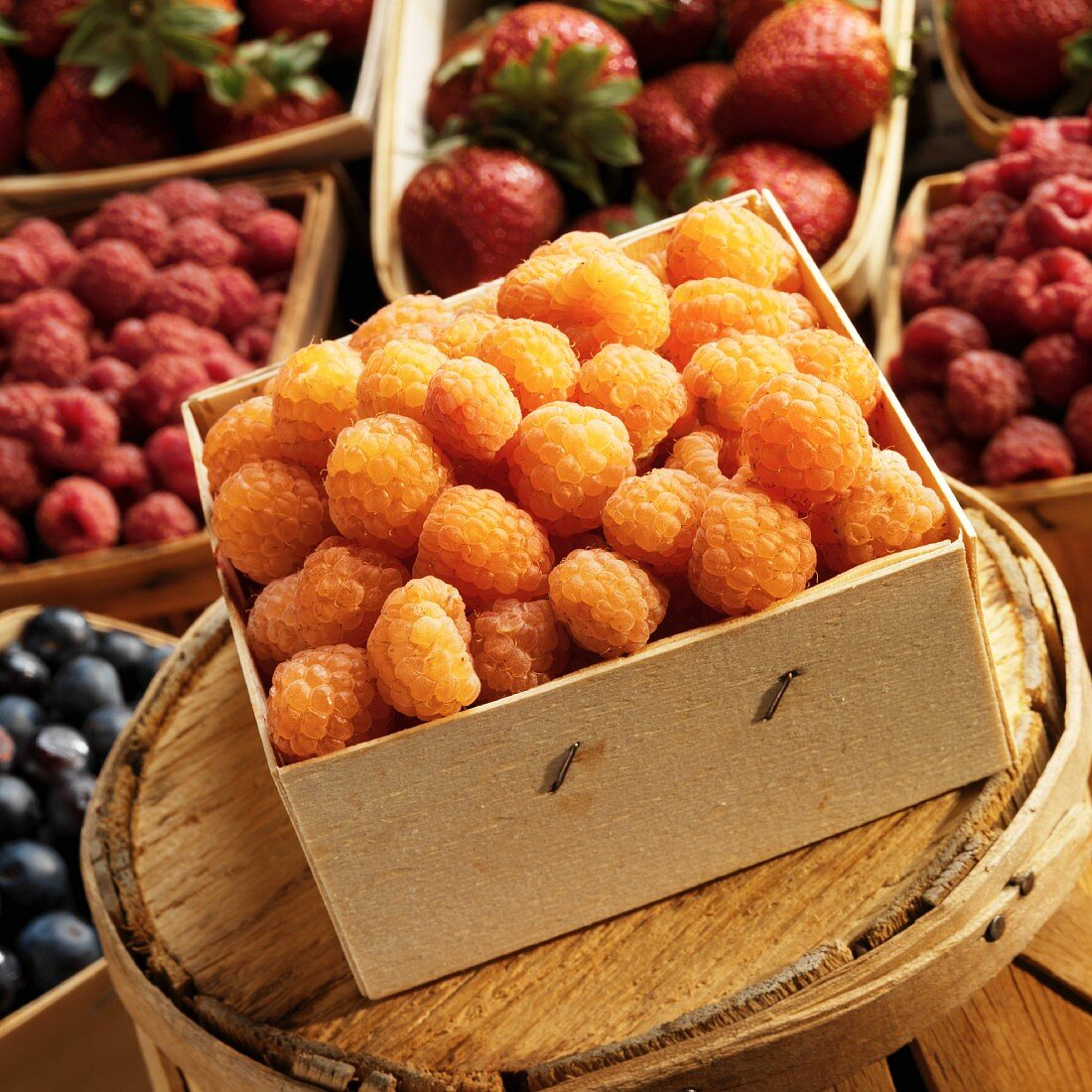 Yellow raspberries in a wooden box