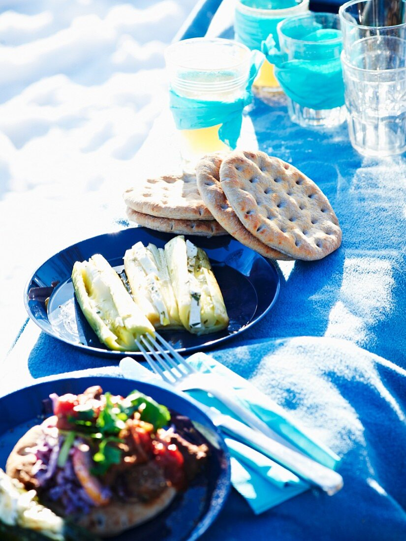 Stuffed leeks and unleavened bread with sausage and tomato for winter picnic