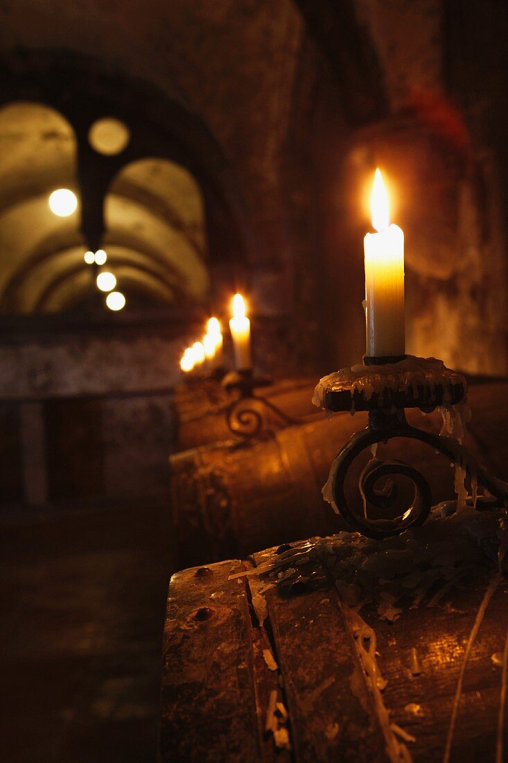 Wine barrels by candlelight