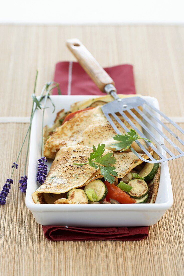 Pancakes filled with vegetables, au gratin
