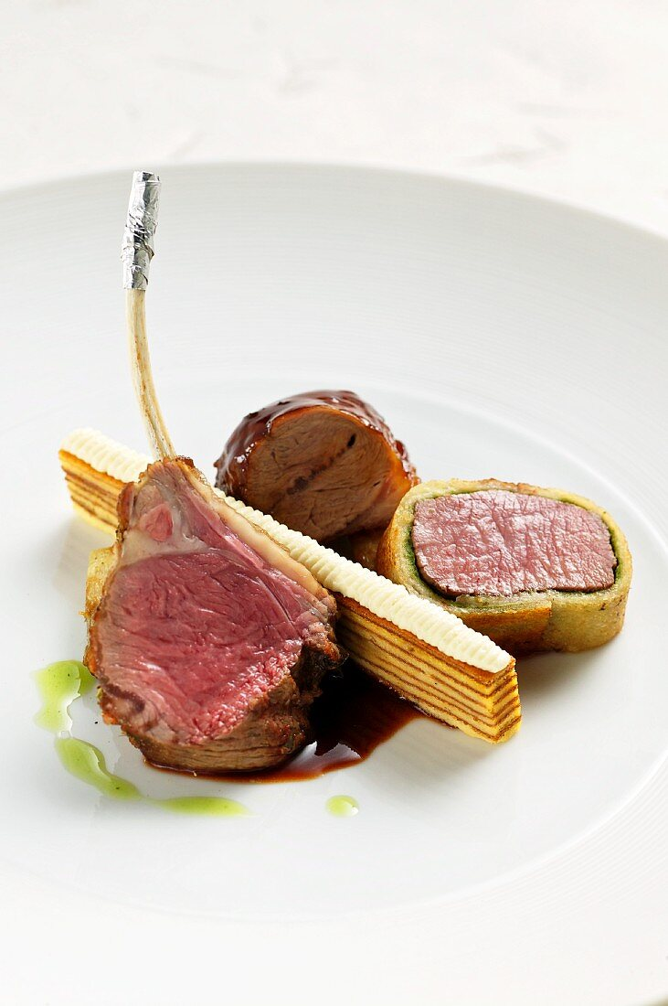 Shoulder and saddle of lamb with German layer cake