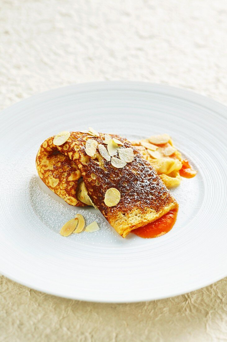 Austrian cheese-filled pancakes with apricot sauce