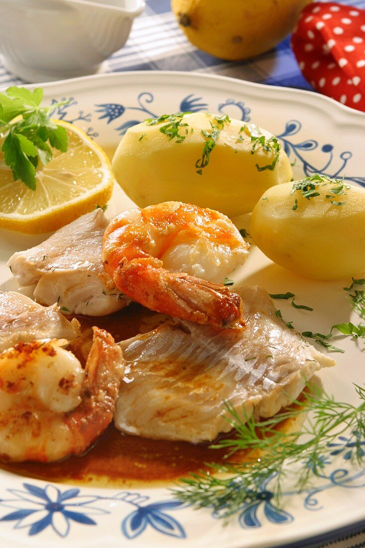 Holstein style cod with scampi and salted potatoes