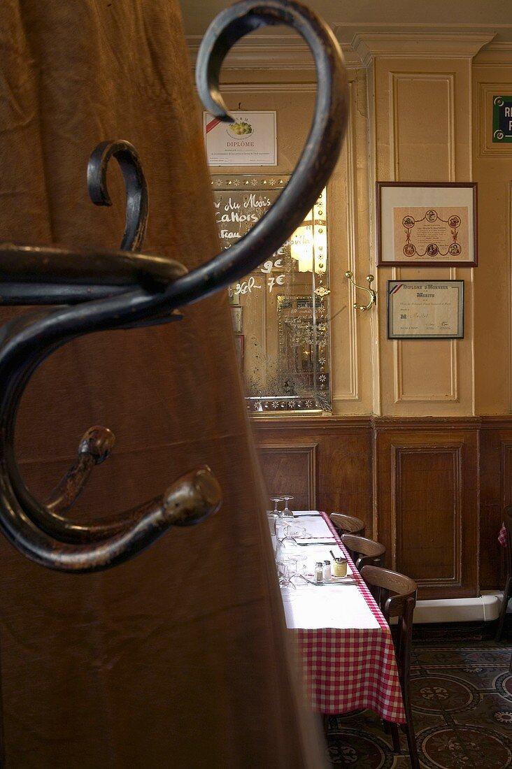 A view through a crack in a door into a restaurant