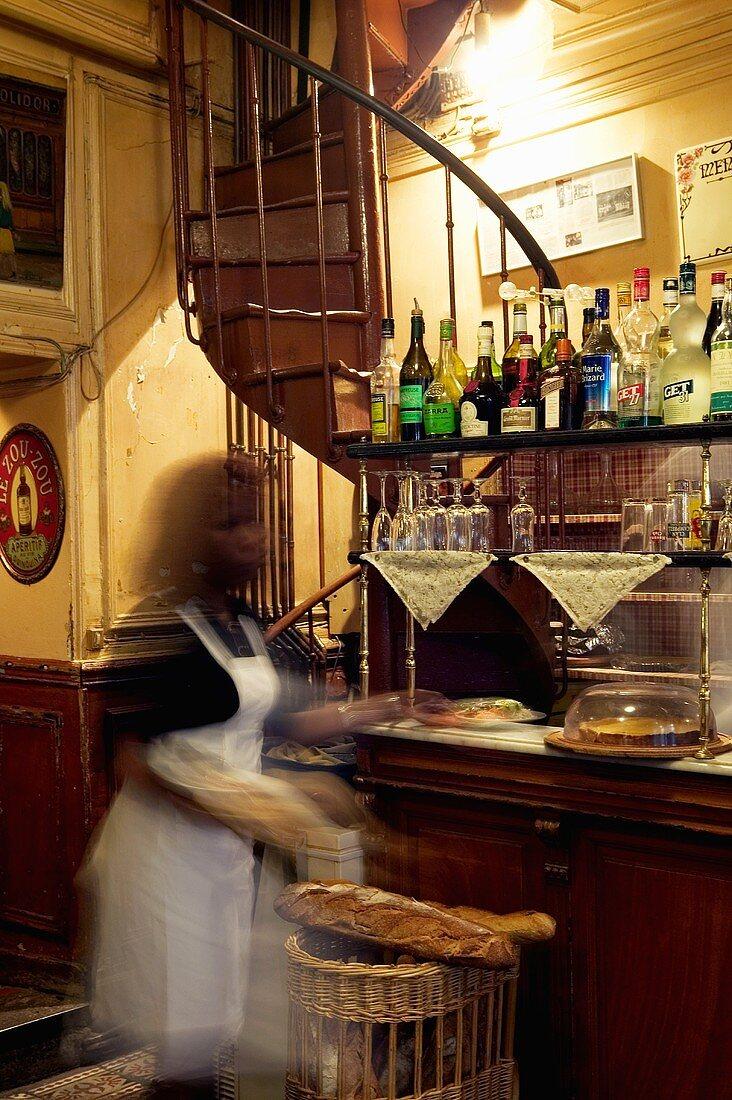 A waitress at a bar in a restaurant