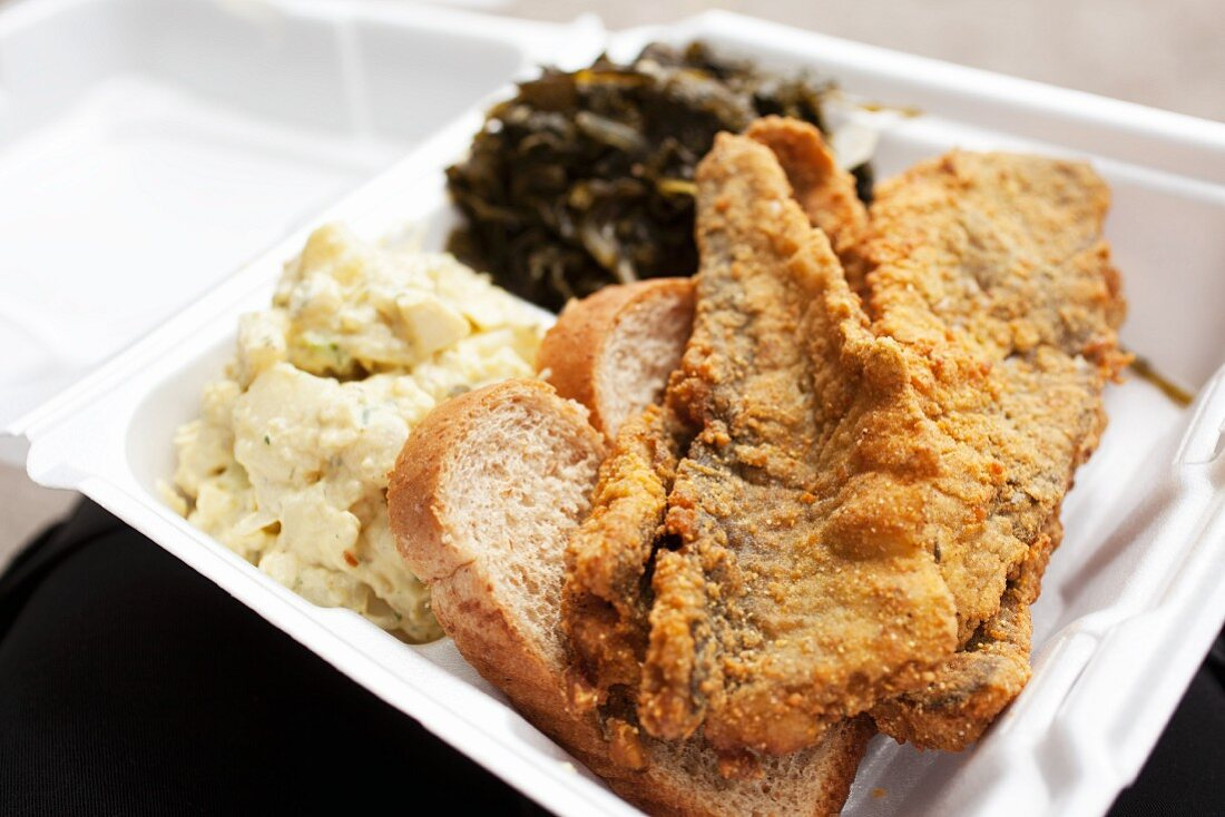Fried Fish with Potato Salad and Greens in To Go Container