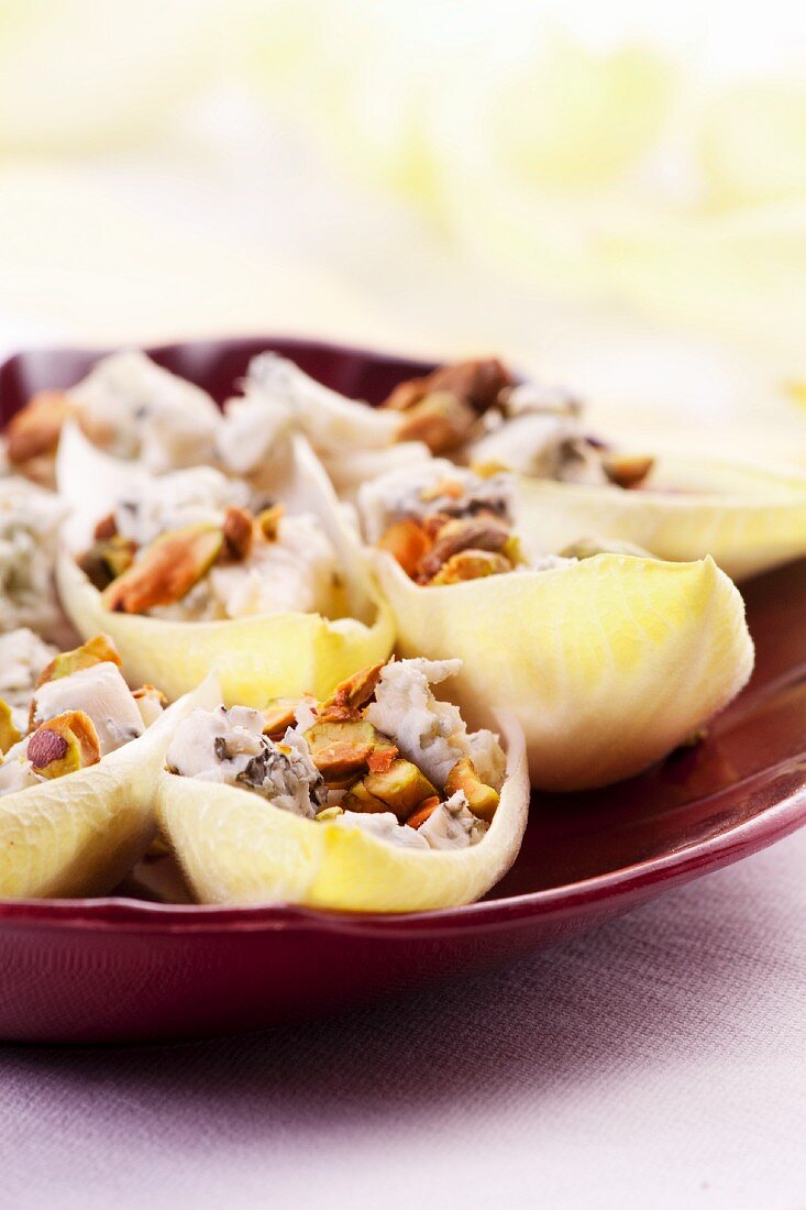 Chicory boats filled with blue cheese and walnuts