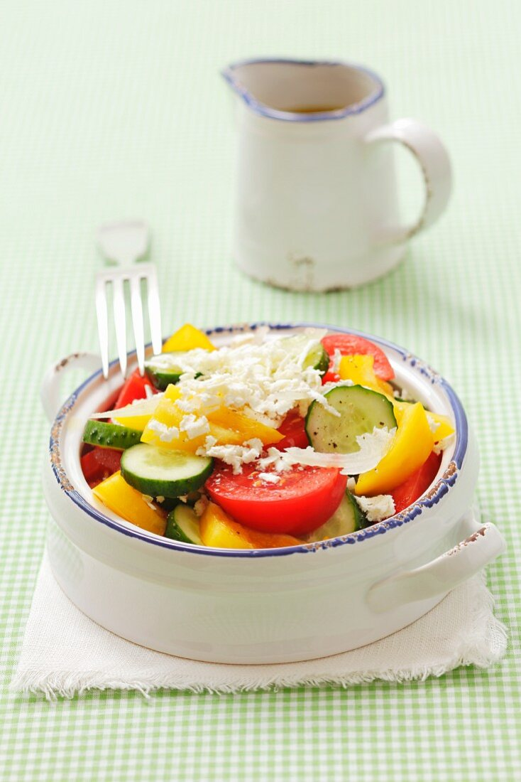 Szopska (Bulgarian salad made with cucumbers, tomatoes, onions, pepper and sheep's cheese)