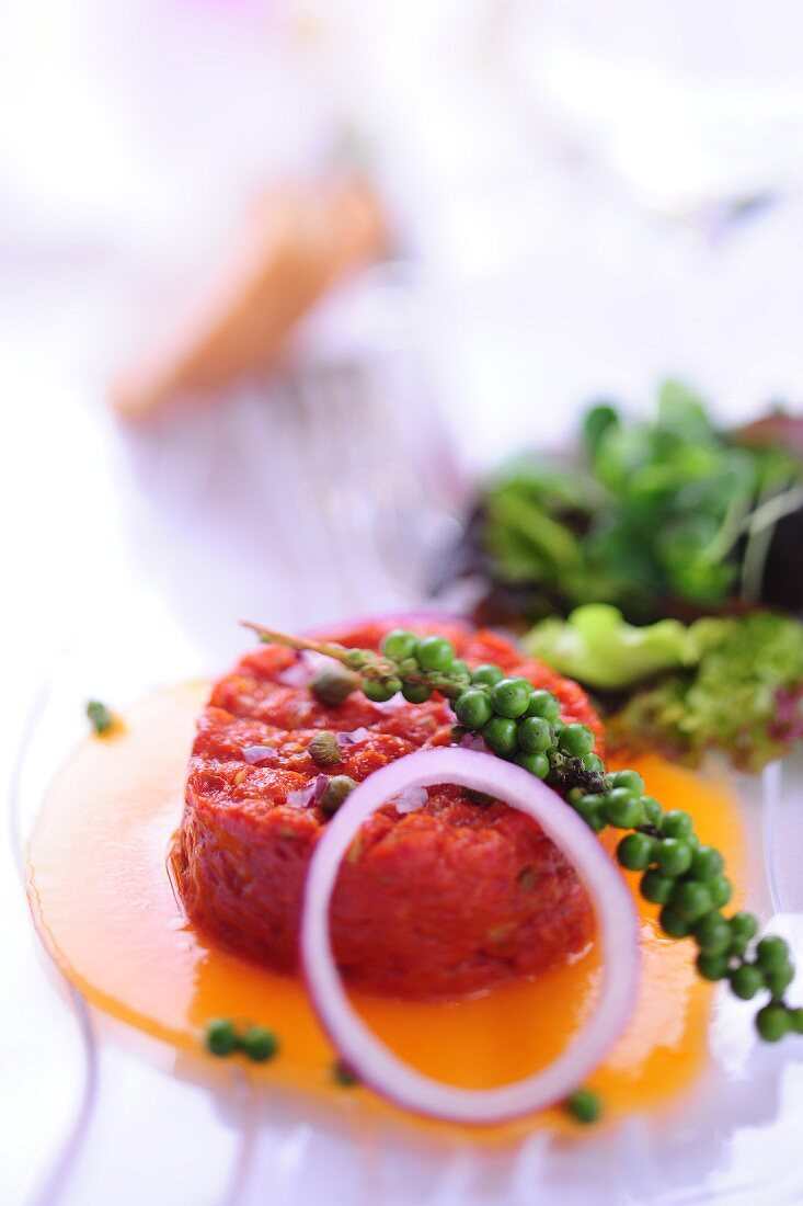 Steak tartare with egg, onion and green pepper