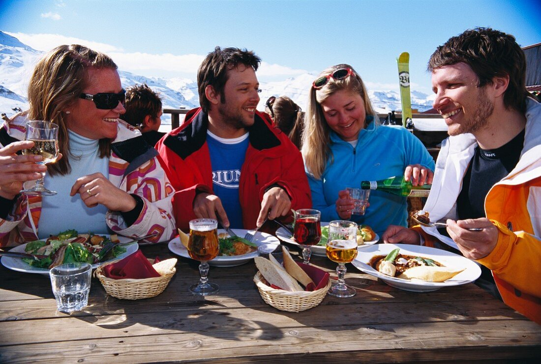 People having lunch outside a ski hut (France)