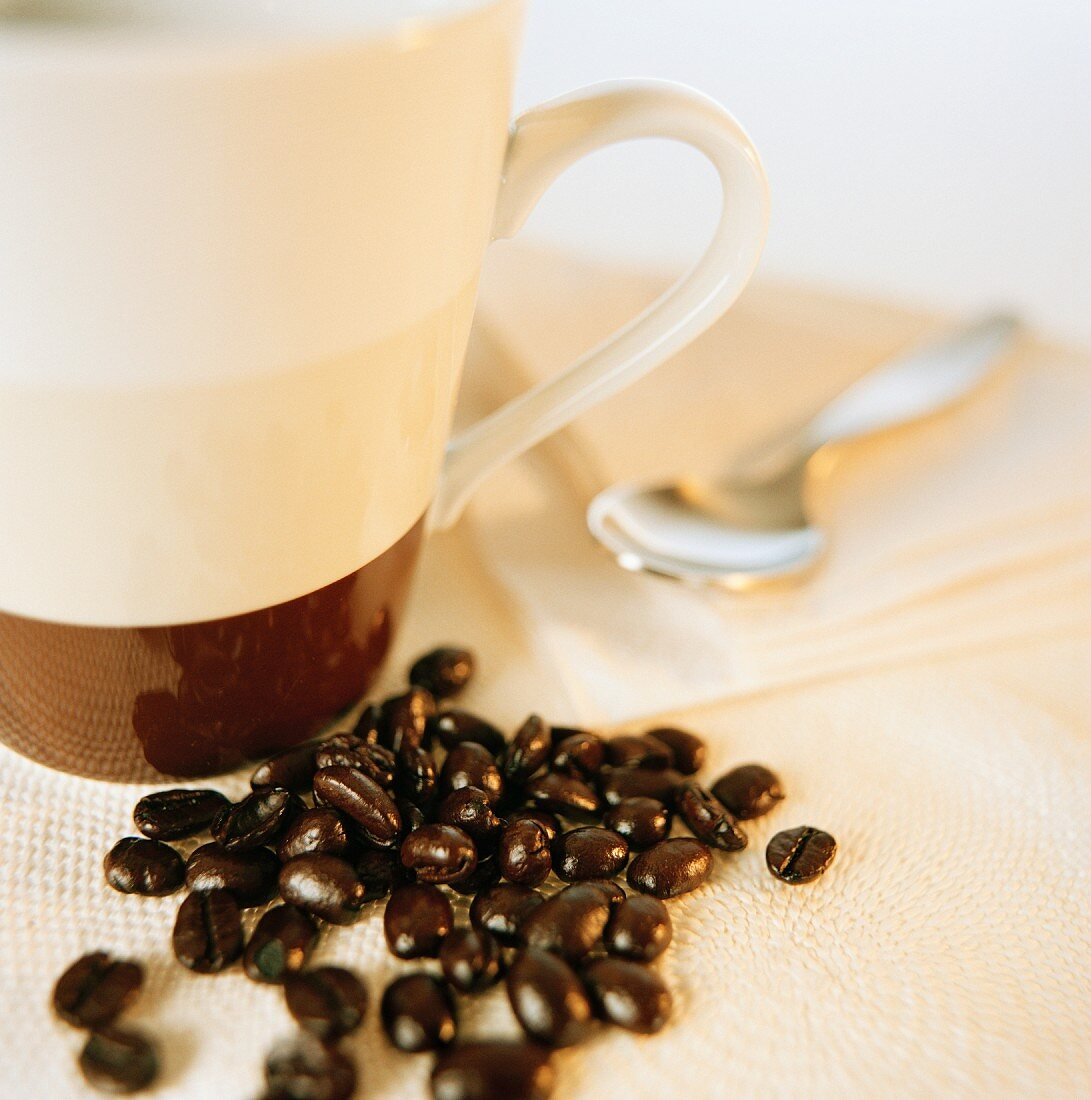 Coffee beans and a coffee cup