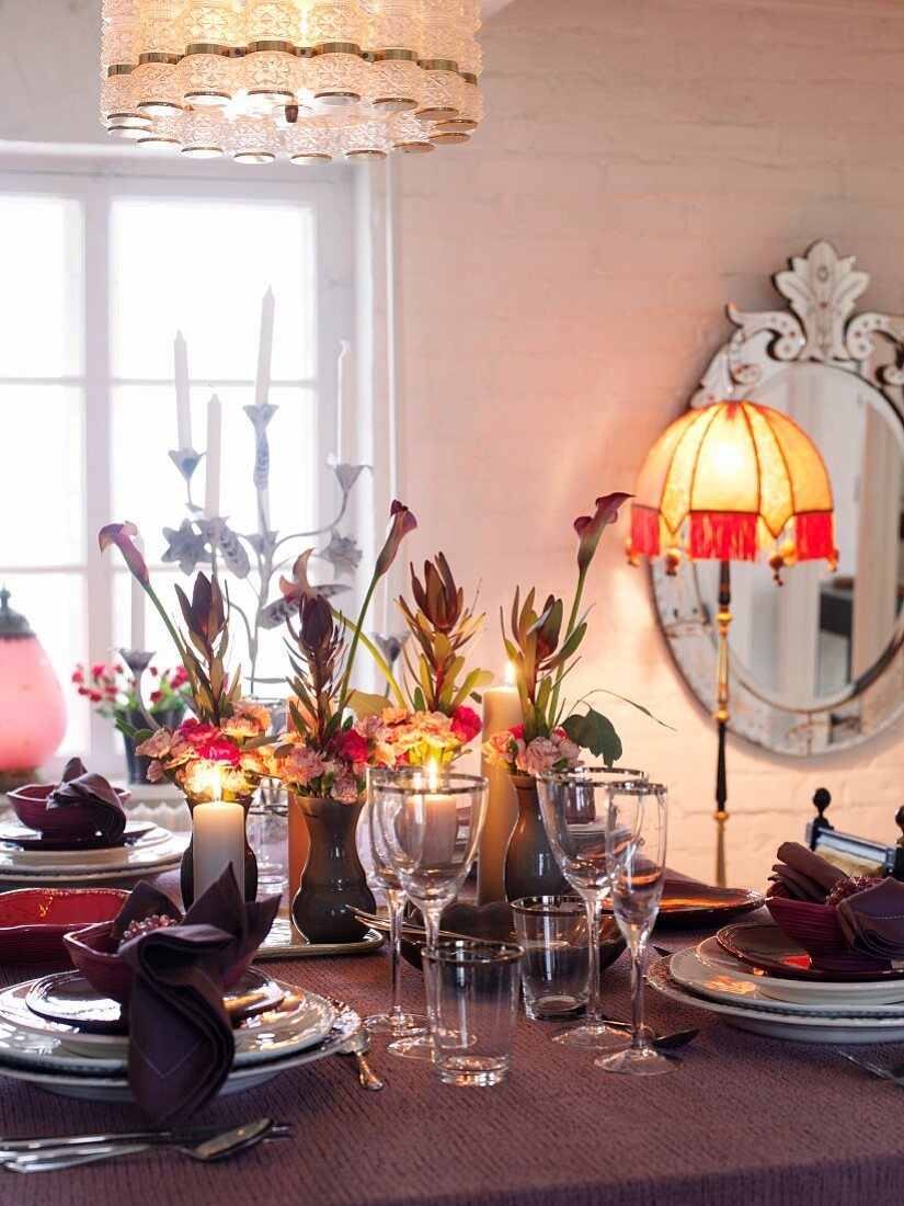 Festive table laid with candles and lamps