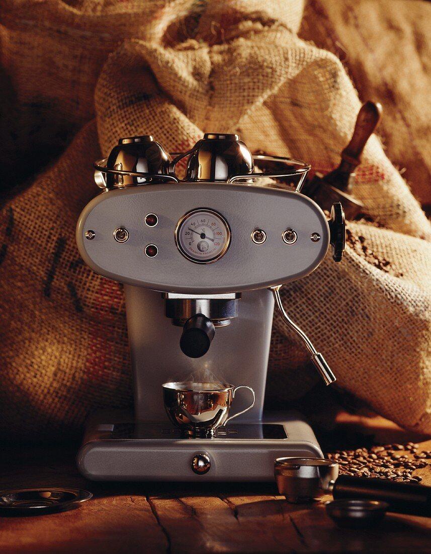 Espresso machine in front of jute sacks