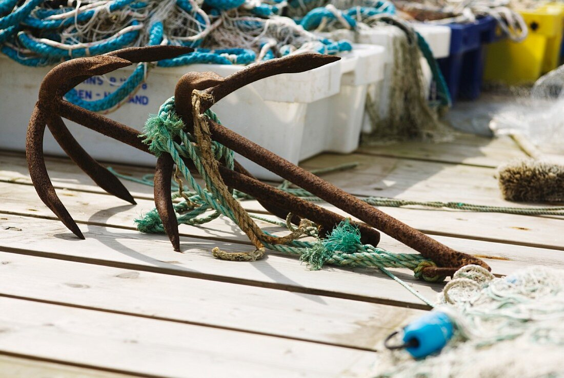 Boat deck with anchors, boxes and fishing nets