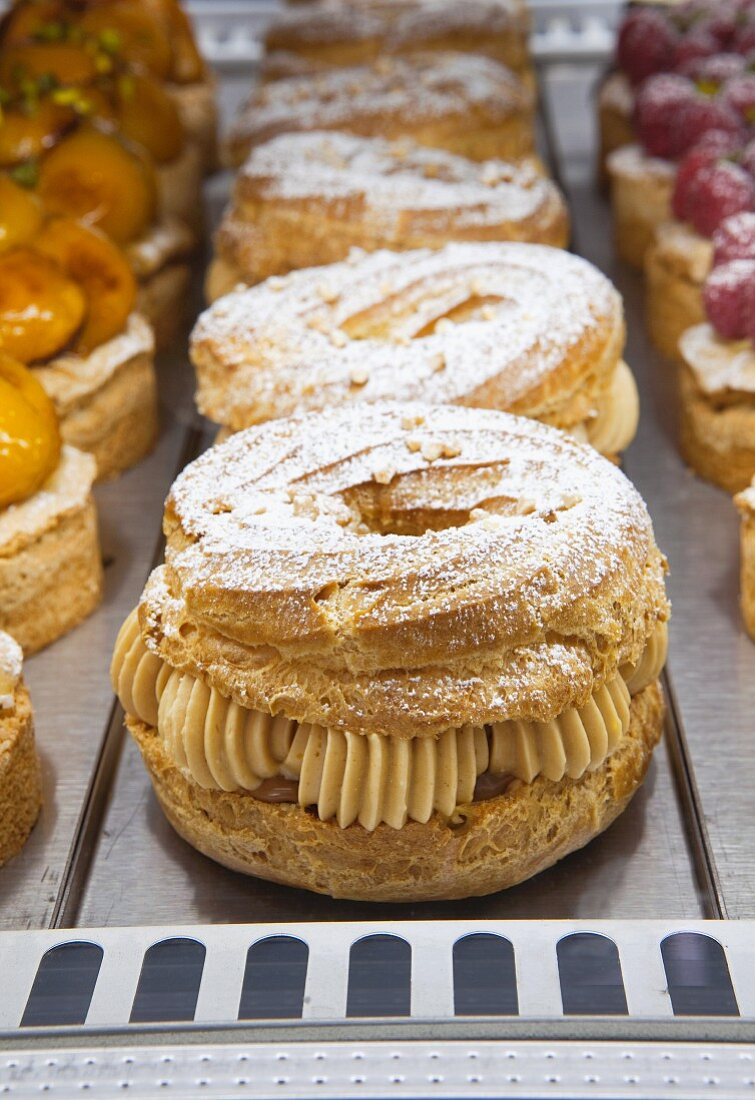 Paris Brest (puff pastry with nougat creme, France) in a display cabinet
