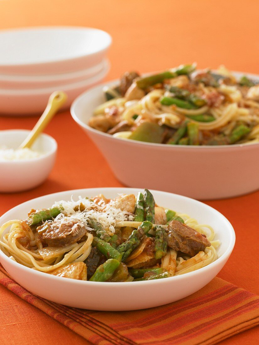 Bowl of Pasta with Beef and Asparagus; Shredded Parmesan