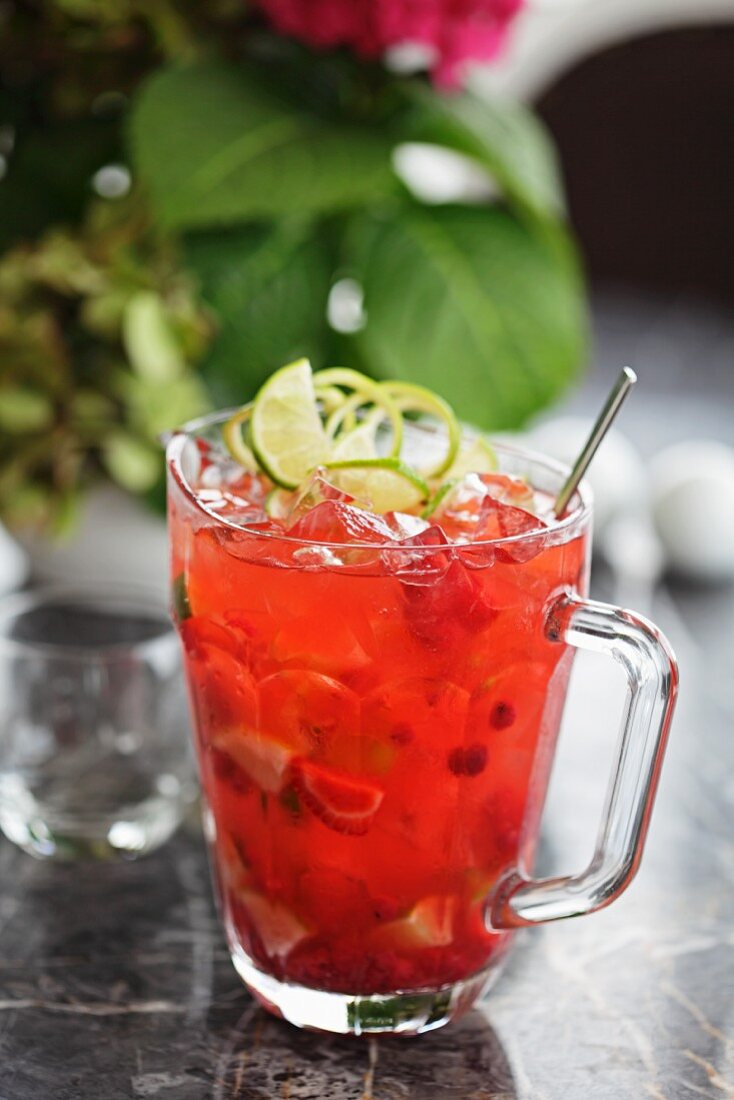 A vodka cocktail with raspberries and oranges